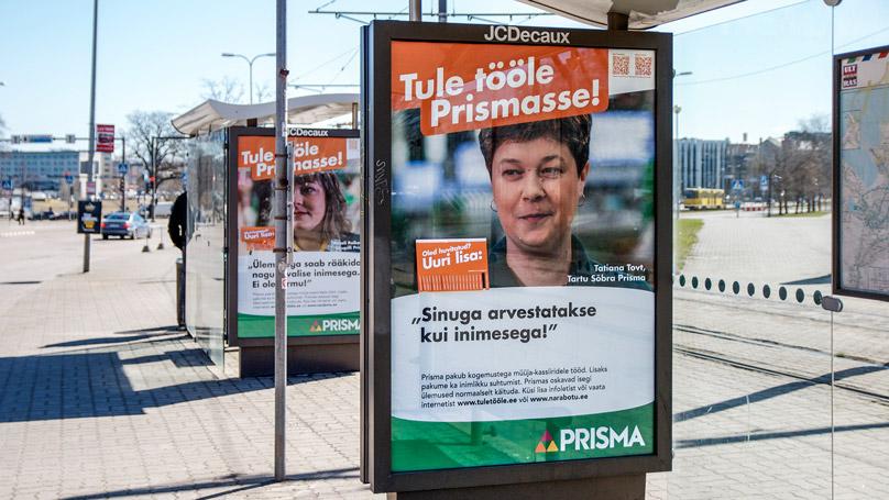 Actual Prisma employee on an outdoor poster